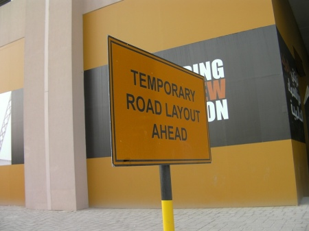 Permanent sign about temporary road layout
