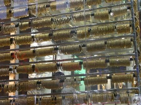 jewellry store window full of golden bracelets, Deira gold souk, Dubai