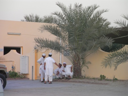 four men outside a mosque