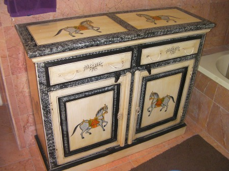 cabinet painted with ponies on it