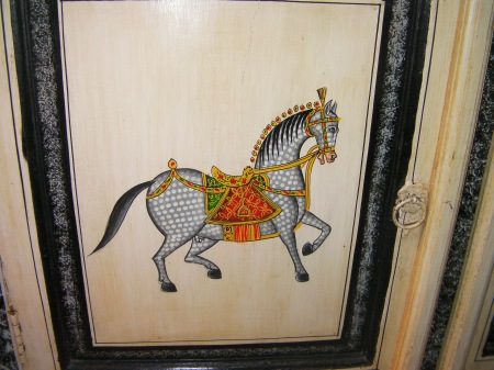 close up of pony painted on cabinet