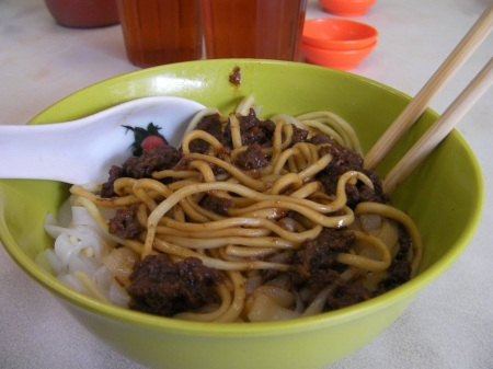 bowl of beef, rice noodles and egg noodles
