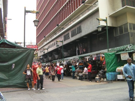 booths lining the street selling cheap handbags and sunglasses