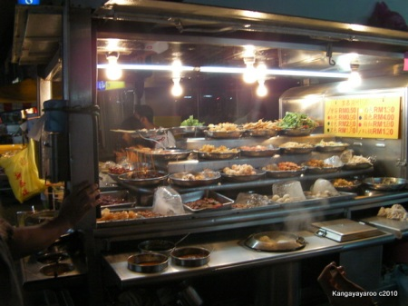 cart full of foods on skewers