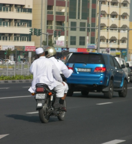 two men on a motorcycle