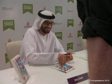 Qais Sedki, author, signing a book