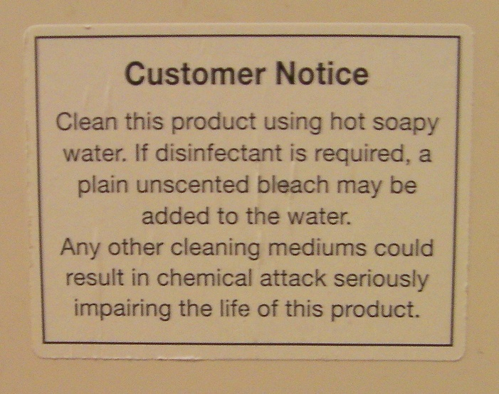 sign outlining toilet cleaning instructions