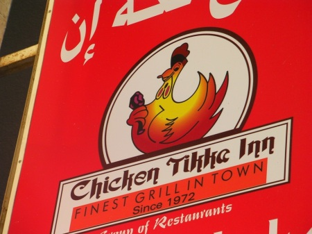 Sign showing a chicken holding a drumstick