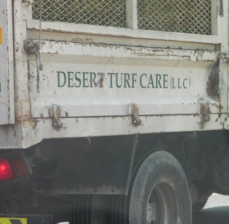 "sign on a truck ""desert turf care"""