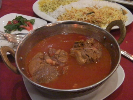 bowl of lamb in a red stew