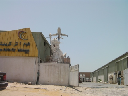 industrial yard with a statue of liberty replica