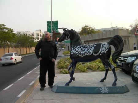 Arabian horse public art statute and a man