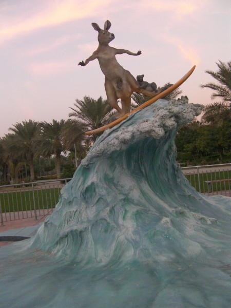 sculpture of a kangaroo surfing