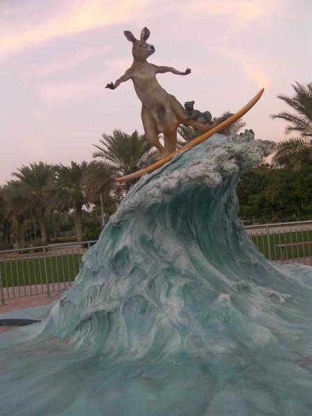 sculpture of a kangaroo surfing