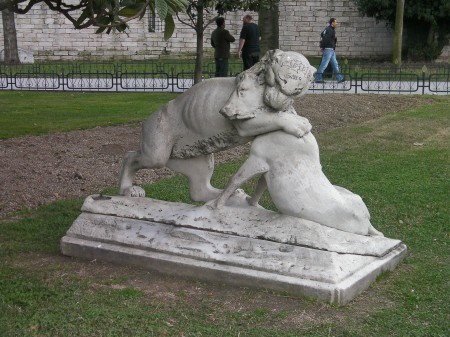 statue of a lion killing a wildebeast