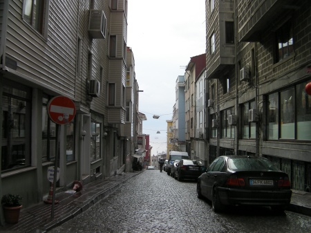 view down a cobblestone street to the sea of MarMara
