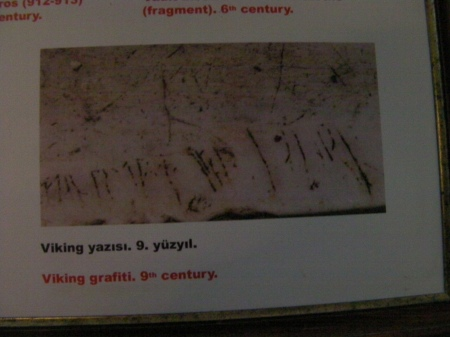 sign showing carving in the marble by a Viking