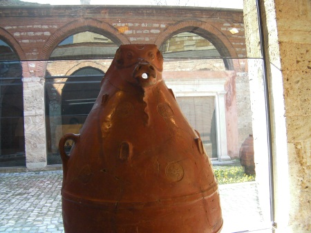large clay pot with an animal head and mouth spout