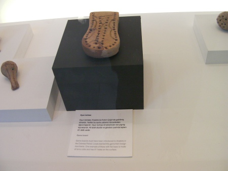clay game board similar to a cribbage board