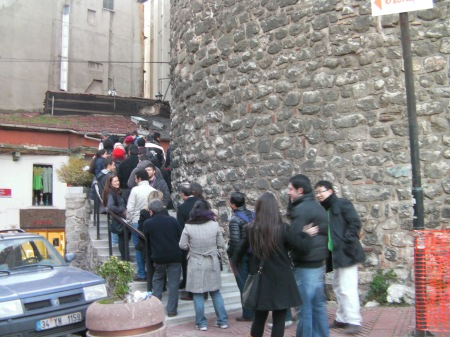 long line of people waiting to go into the tower