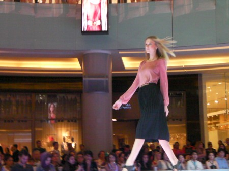 pink blouse and black pleated skirt