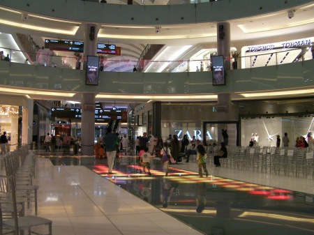 kids running and playing on the lighted mall floor