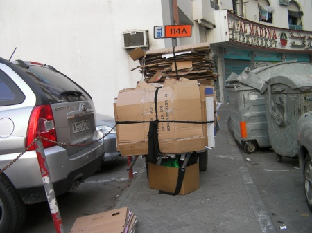 cart loaded with flattened cardboard boxes