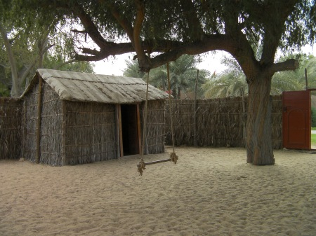 hut and fence made out of palm fronds