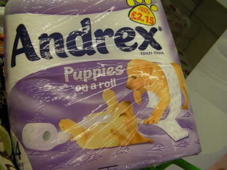 """toilet paper package stating """"puppies on a roll"""""""