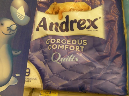 """toilet paper package stating """"gorgeous comfort quilts"""""""