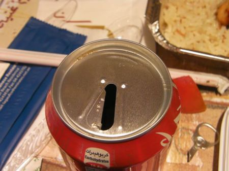 only half of the tab pulled of the coke can