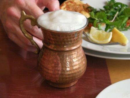 brass mug of yogurt drink