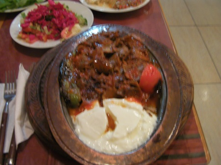 plate of meat, tomato sauce and yogurt
