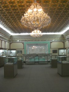 room with display cases and an ornate ceiling