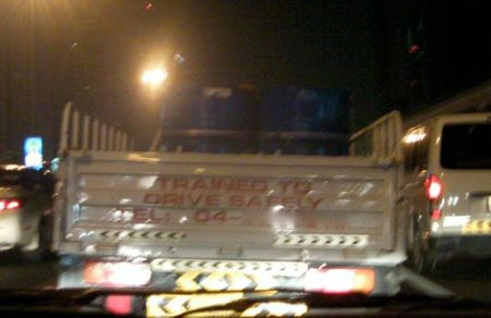 """lettering on vehicle stating """"trained to drive safely"""""""