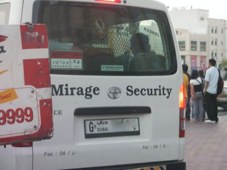 "van with ""mirage security"" written on it"