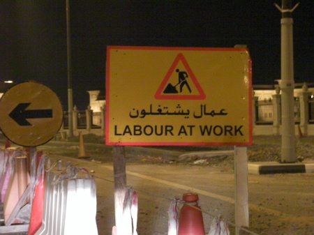 "caution sign stating ""labour at work"""