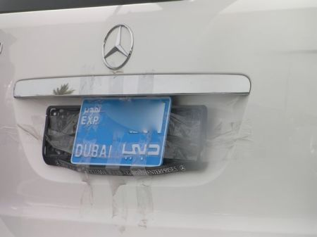 car license plate taped onto the car