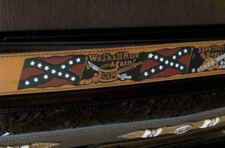 leather belt with the Confederate flag and the words we shall rise again