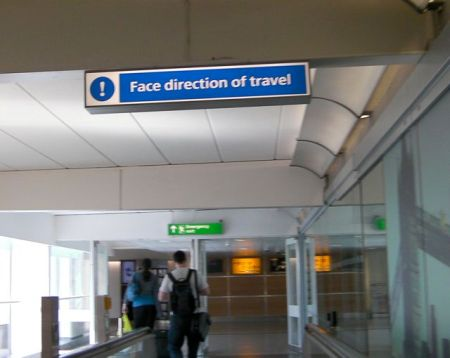 sign stating face direction of travel