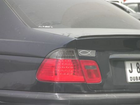 Christian fish symbol on the back of a car
