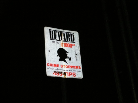 Crime watch sign with Sherlock Holmes sillouette