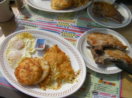 eggs, biscuit, hash browns and two pork chops