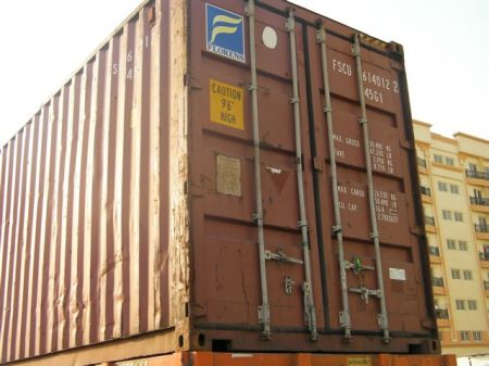 "freight container with a sign ""caution nine feet six inches high"""