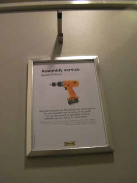 sign on restroom stall door regarding furniture assembly services
