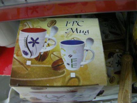 coffee mug that includes a spoon