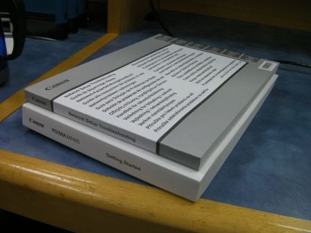 two thick printer manuals