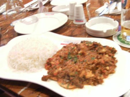 plate of white rice and meat in red sauce