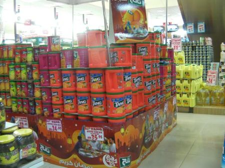 store display of stacked large containers of Tang drink mix