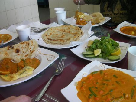 plates and bowls of Indian food